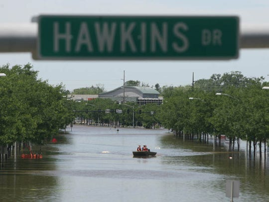 Rescue workers patrol the floodwaters along Highway 6 in Coralville on Friday, June 13, 2008.