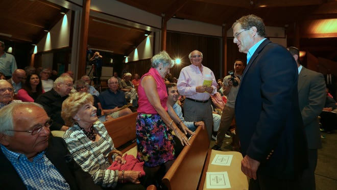 AJC Executive Director David Harris, right, greets the audience before his speech against the nuclear deal with Iran at Congregation Emanu-El of Westchester in Rye Aug. 26, 2015.