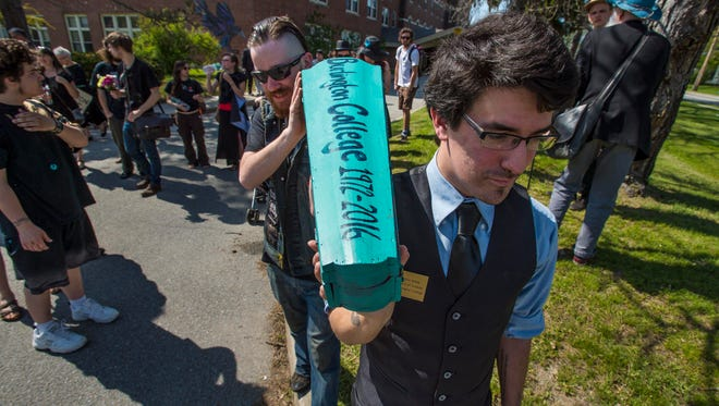 Student John Chamis, left, and alum Dylan Kelley carry a small coffin Burlington College students, alum, staff members and supporters gathered for a march and mock funeral for the school on Friday, May 20, 2016.