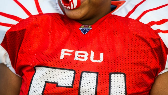 Broward player Jonathan Miller watches from the sideline during the FBU National Championships for 7th grade at First Baptist Academy on Tuesday, Dec. 20, 2016. Broward won against Dallas Metro with a final score of 42-24.