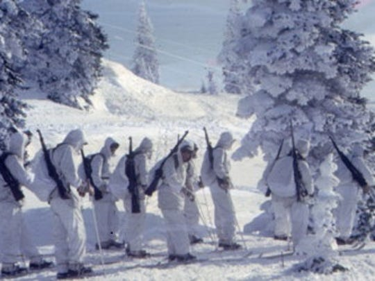 A group of 10th Mountain Division soldiers in full winter fighting gear.
