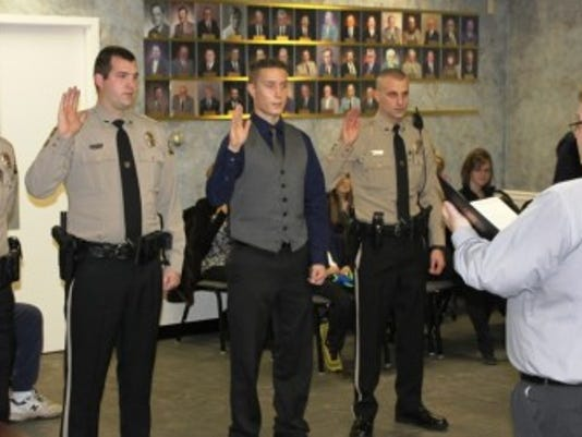 Officers Matthew Cicale, Ryan Leen, Kevin Mengel, and Kevin Leiss are sworn in by Board Chairman Mayor Rick Pope. Photo Submitted