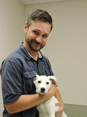 Dr. Wenzel with one of three puppies that were found in a dumpster in Lordsburg, NM. All three puppies suffering with parvo were nursed back to health and are doing well.