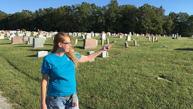 Fairview resident Stacey Givens explains how she encountered a couple having sex in a truck near her husband's grave site in Hudgins Cemetery.