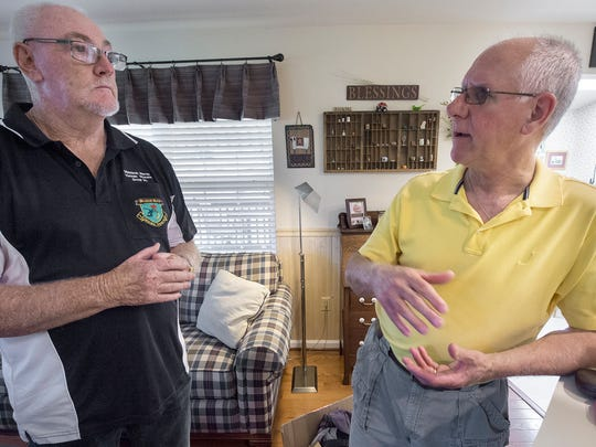Colin Gibson, of Australia, left, meets Tim Blessing at his Windsor Township home Wednesday. The pair met briefly as soldiers in the Vietnam War in 1967.