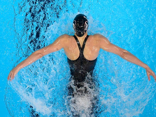 Hali Flickinger swims in the women's 200-meter butterfly