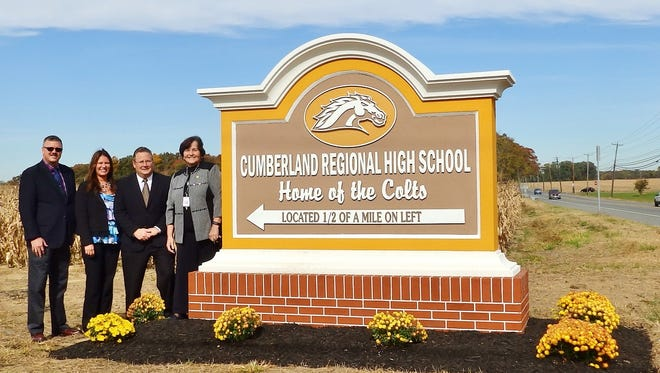 (From left) Thomas M. Davis, president, Cumberland Regional Board of Education, Lana Latella, vice president/market development manager, Cape Bank, Edward Geletka, executive vice president/chief operating officer, Cape Bank, and Mary Lou DeFrancisco, interim superintendent, Cumberland Regional School District, celebrate the installation of the new Cumberland Regional High School monument sign at the intersection of Route 77 and Silver Lake Road.