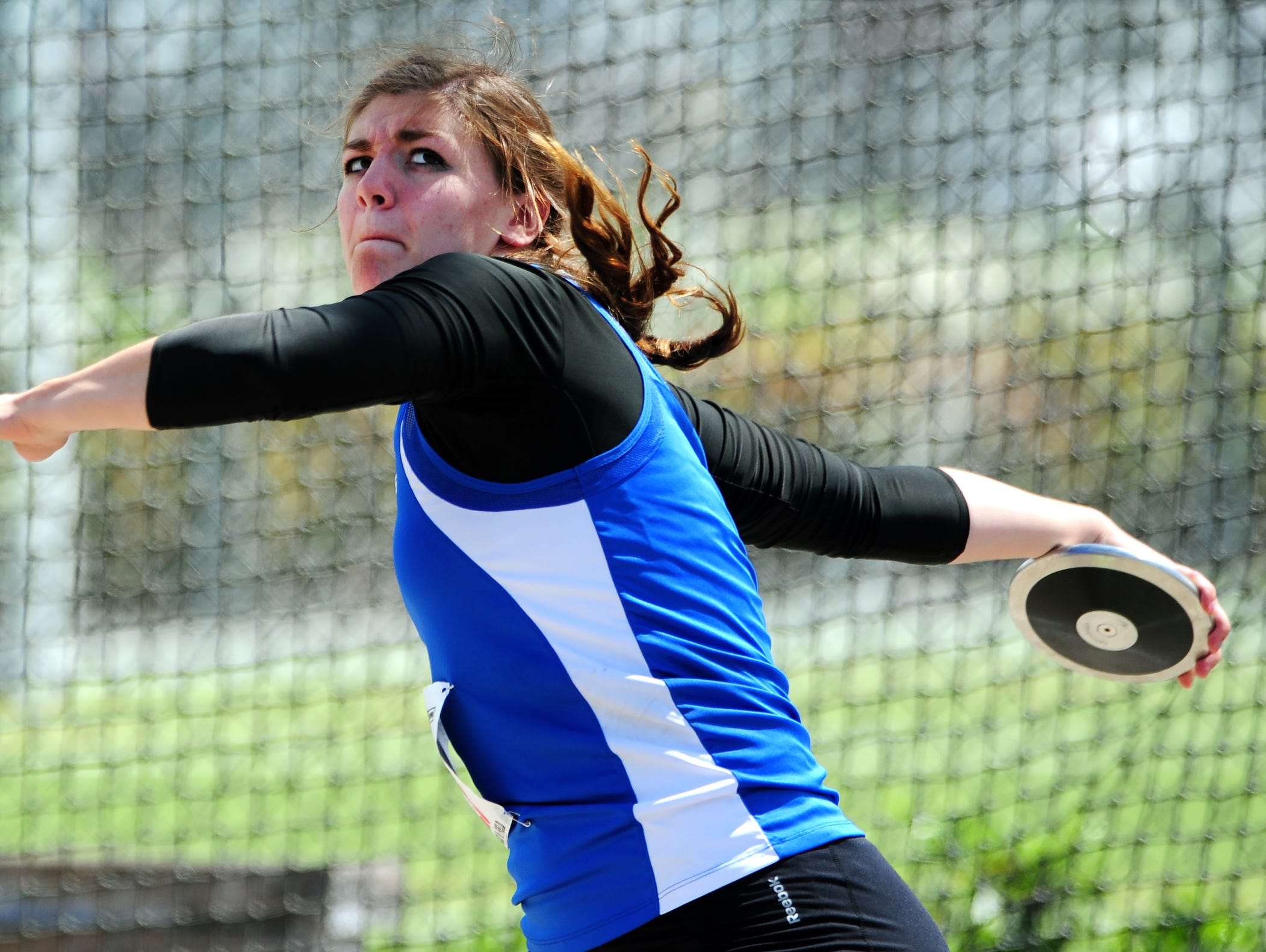 """Amity's Lindsay McShane throws the discus during the OSAA Class 3A Track & Field Championships inside Hayward Field at the University of Oregon, on Thursday, May 21, 2015, in Eugene. McShane would repeat as state champion with a throw of 144'7""""."""