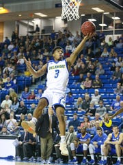 Delaware guard Anthony Mosley spins past a defender for a layup in the first half against Hofstra at the Bob Carpenter Center Saturday.