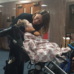Foster parent Jessica Roy comforts her two-year old adopted daughter Juno, who has multiple physical disabilities.