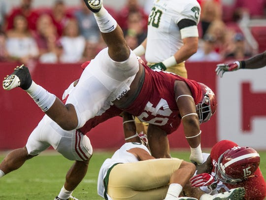 Alabama defensive lineman Isaiah Buggs (49) and defensive