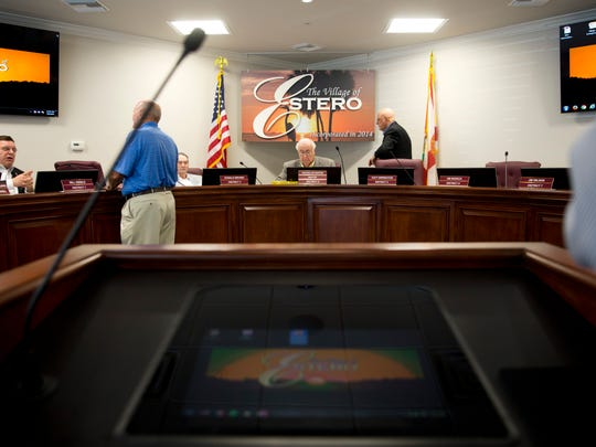 Members of the Village Council and others mull around during a five minute break taken during a Village of Estero council meeting Wednesday, July 6, 2016, in Estero, Fla. The recently installed timer, which counts down from three minutes, is a helpful tool to keep public presentations prompt and the meetings running smoothly.