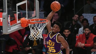 Utah Jazz guard Donovan Mitchell (45) dunks over children and American actor Kevin Hart in the slam dunk contest during the 2018 All Star Saturday Night at Staples Center.