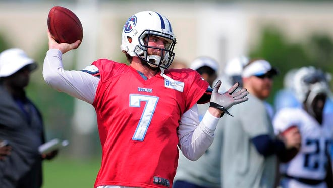 Titans quarterback Zach Mettenberger throws a pass during practice at Saint Thomas Sports Park on Wednesday.
