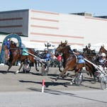 Papagayo E, right, overtakes Creatine, left, to win the $1 million International Trot Saturday.