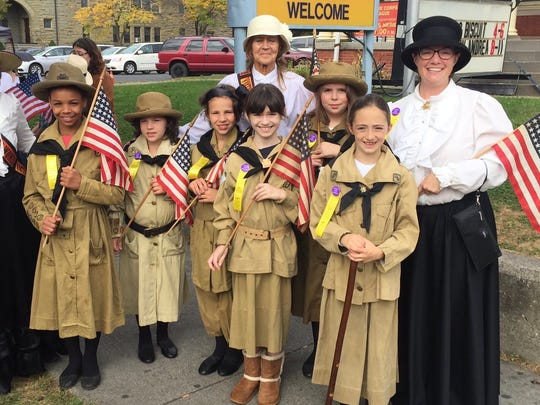 Girl Scouts dressed in suffrage-era uniforms prior to marching in the suffrage parade re-enactment.