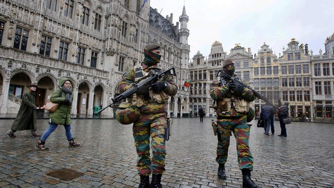 Police officers patrol the Grand Place in central Brussels.