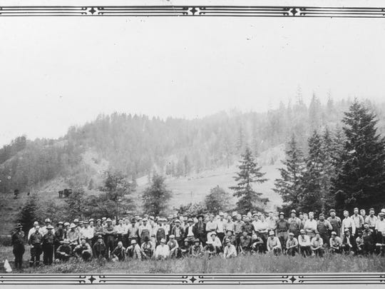 This 1930's era photo supplied by the U.S. Department of Agriculture, Forest Service shows a crew of forest workers in Tiller, Ore. Almost all of the downtown in Tiller, a dying timber town in remote southwestern Oregon, is for sale for $3.5 million and the elementary school is for sale separately for $350,000. A potential buyer has come forward but is remaining anonymous -- and back-up offers are still being accepted.