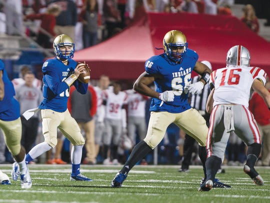 McEachern quarterback Bailey Hockman looks to make a pass as his teammate Jalen Jackson blocks Archer's Frank Finch during week two of the state playoffs at McEachern.