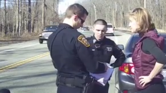 Tenafly police officers converse with Caren Turner after a traffic stop of a car in which her daughter was a passenger.