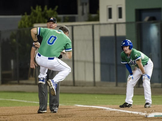 FGCU coach Dave Tollett leaps to stomp his feet in