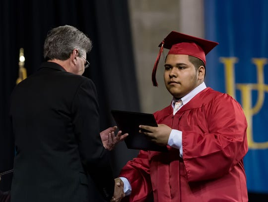 Students receive their diplomas at the William Penn