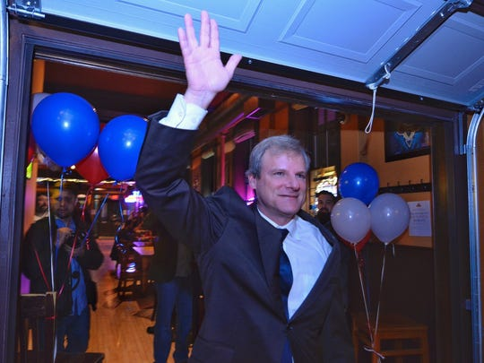 York City Mayorial candidate Michael Helfrich waves to the crowd gathered at Holy Hound, Tuesday, Nov. 7, 2017. John A. Pavoncello/jpavoncello@yorkdispatch.com