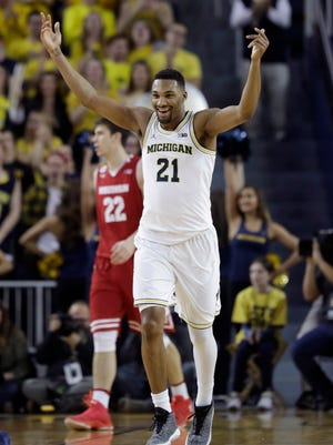 Michigan Wolverines guard Zak Irvin reacts after a three-pointer during the first half against Wisconsin, Thursday, Feb. 16, 2017 in Ann Arbor.