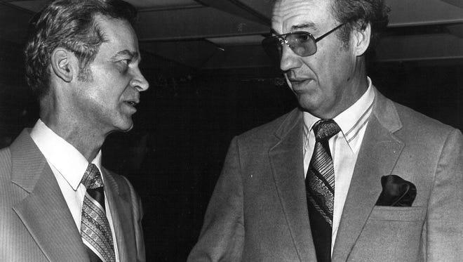 Dr. Julian Bridges, left, talks business with Dr. Jesse Fletcher, while Fletcher was president of Hardin-Simmons University.