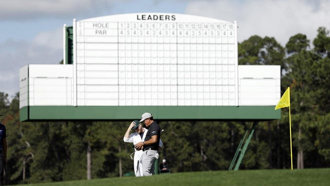Nov 9, 2020; Augusta, Georgia, USA; Phil Mickelson putts on no. 17 during Monday's practice round for The Masters golf tournament at Augusta National Golf Club. Mandatory Credit: Andrew Davis Tucker/The Augusta Chronicle