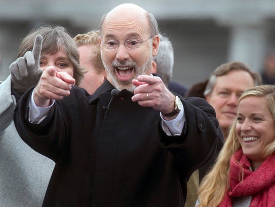 Tom Wolf, right, and his wife, Frances, left, stand before the crowd at his inauguration on Jan. 20, 2015.
