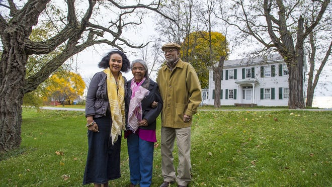 Lydia Clemmons, left, poses with her parents, Lydia Clemmons and Dr. Jackson Clemmons, at their family farm in Charlotte on Thursday. The property is being added to the Vermont African-American Heritage Trail.