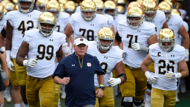 Oct 7, 2017; Chapel Hill, NC, USA; Notre Dame Fighting Irish head coach Brian Kelly leads the team on to the field at Kenan Memorial Stadium. Mandatory Credit: Bob Donnan-USA TODAY Sports