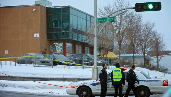 Municipal police patrols the scene of a fatal shooting in a Quebec City mosque during evening prayers on Jan. 29, 2017.