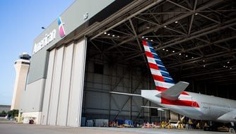 The tail of an American Airlines Boeing 777 peeks out of a hangar at Dallas/Fort Worth International Airport on Oct. 14, 2016.