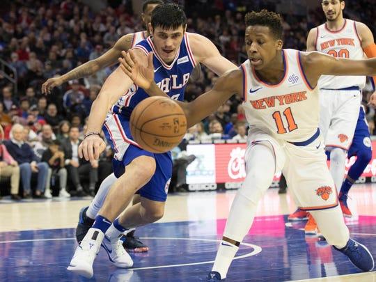 Philadelphia 76ers forward Ersan Ilyasova (23) and New York Knicks guard Frank Ntilikina (11) play for a loose ball during the second quarter at Wells Fargo Center.