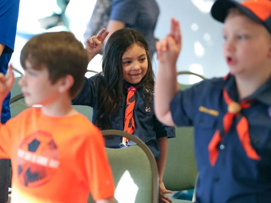 "Alexandra ""A.J."" Gardner, 6, of Middletown takes part in a  Cub Scout pack meeting in Townsend. She was the first girl in Delaware to join a Cub Scout group."