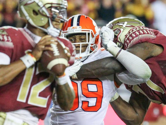 Clemson defensive end Clelin Ferrell (99) pressures Florida State quarterback Deondre Francois (12) during the fourth quarter on Saturday October 29 at Doak Campbell Stadium in Tallahassee, Florida.