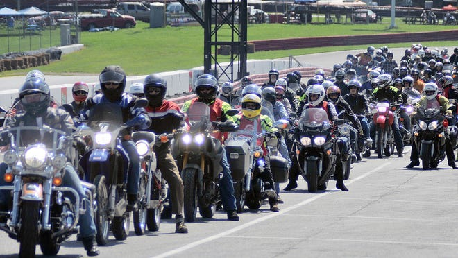 Bikers line up for a ride during lunch at the AMA Vintage Motorcycle Days at Mid-Ohio in 2015.