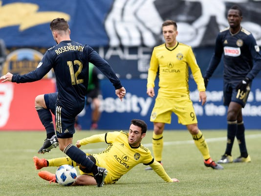 Columbus Crew's Milton Valenzuela (19) steals the ball away from Philadelphia Union's Keegan Rosenburry (12) in the second half of an MLS soccer match, Saturday, March 17, 2017, in Chester, Pa. The game ended 0-0. (AP Photo/Michael Perez)