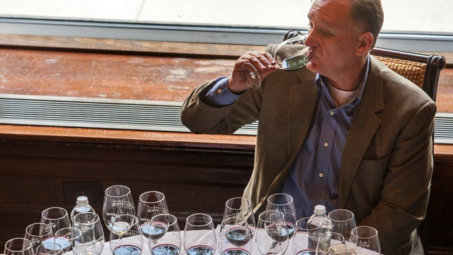 Craig Krutzhals tastes a glass of wine at the MidAtlantic Wine + Food Festival's 1,000-Point Wine Tasting at Hotel du Pont's Green Room last Saturday.