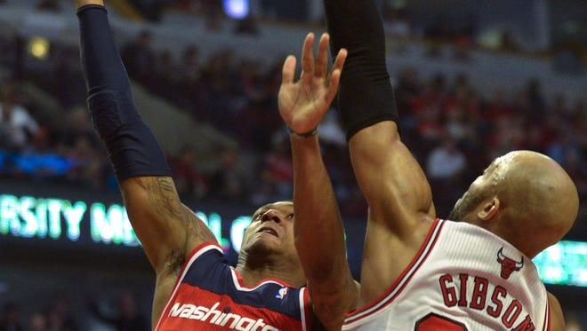 Chicago Bulls forward Taj Gibson (22) blocks the shot by Washington Wizards guard Bradley Beal (3) in the first half of game five.