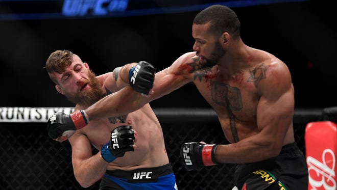 Thiago Santos, right, throws a punch at Gerald Meerschaert during their middleweight fight.