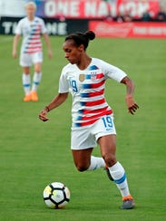 United States' Crystal Dunn moves the ball against