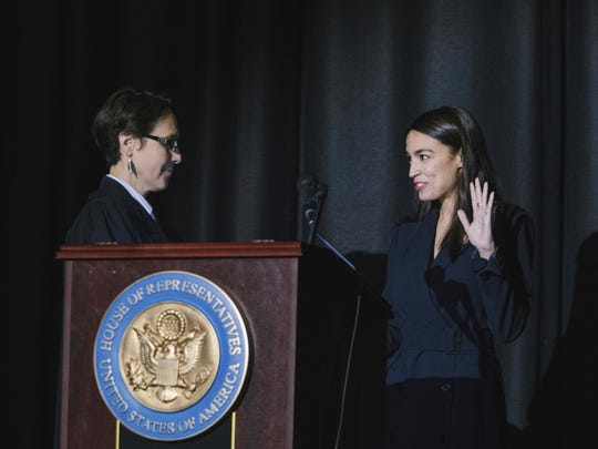 Judge Jenny Rivera officiates the swearing-in ceremony of Congresswoman Alexandria Ocasio-Cortez.