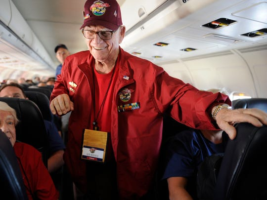 Al Whitfield of Visalia walks up the aisle during the Central Valley Honor Flight from Fresno to Washington, D.C., Monday, Sept. 15, 2014. The 3-day trip honors World War II veterans.