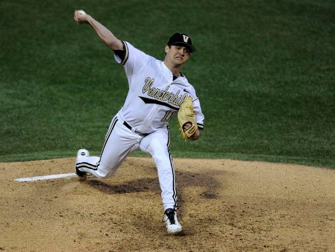 Vanderbilt starting pitcher Tyler Beede, #11, pitches during Game 1 of the Vanderbilt-LSU series at Vanderbilt's Hawkins stadium in Nashville, Tenn., on Friday March 14, 2014.