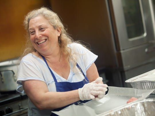 Charna Schlakman shares a laugh with fellow congregation members while preparing stuffed cabbage rolls at the Beth Israel Temple in Jackson. The ladies are preparing for the annual Beth Israel Bazaar.