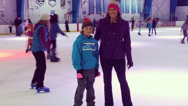 Michelle Mulak and her son chill out at the Space Coast Iceplex in Rockledge. Ice skating burns upward of 600 calories per hour.