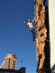 A climber tests out the Grand Canyon Experience climbing wall.
